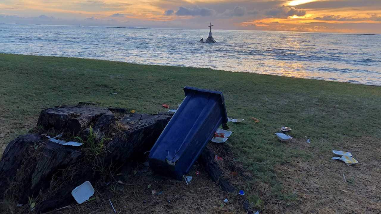 Plastic waste can be found even in the most serene places. Here, it overshadows the beauty of the sunrise and the peacefulness symbolised by the cross. Photo by Sienna Goldstein (Seychelles)
