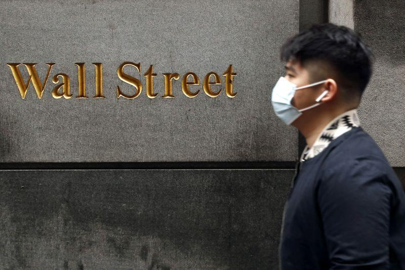 USA stocks end mixed in volatile trading