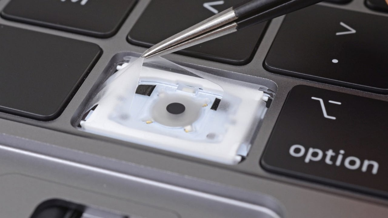 Apple's new MacBook Pro keyboard features a silicone strip to make it quieter