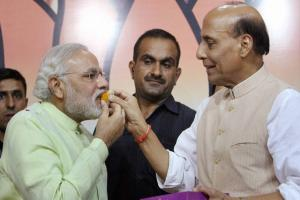 New face, new phase: Images of BJP's race to 2014 under Modi