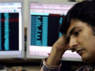 Sensex falls over 200 points in early trade on weak global cues; aviation, OMC stocks surge