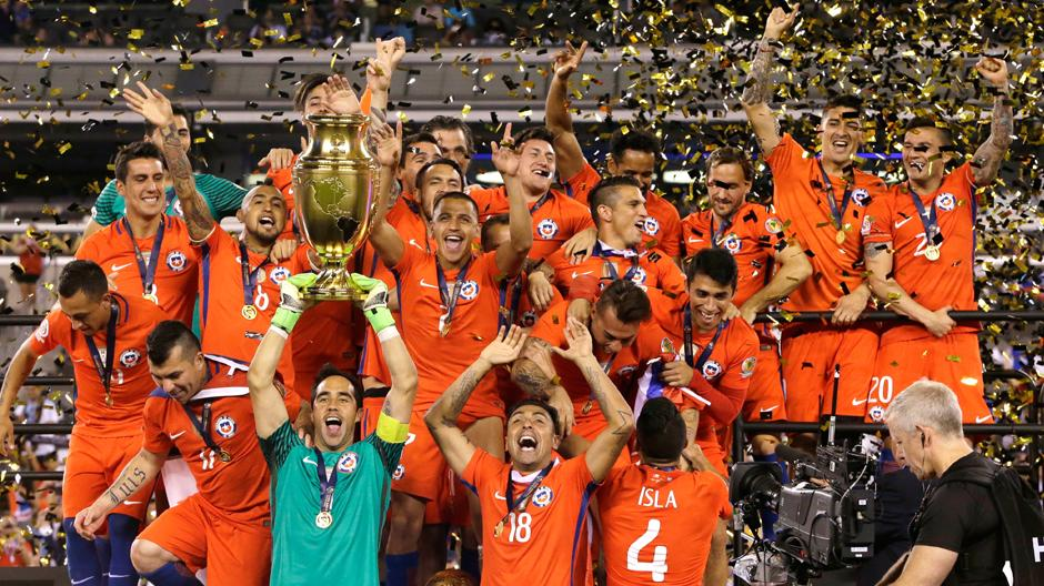 bb6f8bd3c Chile s players celebrate with the Copa America trophy after beating  Argentina in the final on Sunday