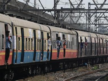 Mumbai Central Railway installs blue light on train doors as pilot project aimed at warning passengers against boarding moving trains