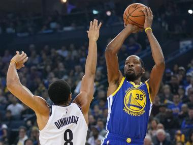 NBA: Kevin Durant shines as Stephen Curry-less Warriors brush aside Nets; LeBron James guides Lakers to easy win over Kings