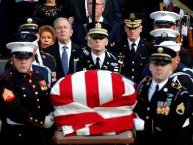 America bids farewell to George HW Bush: Son George W Bush calls him 'brightest of a thousand points of light'