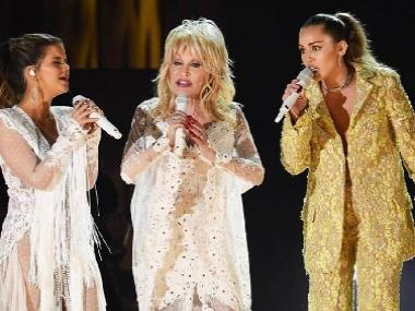 Grammys 2019 highlights: Dolly Parton joins Miley Cyrus in tribute performance; BTS presents award to H.E.R