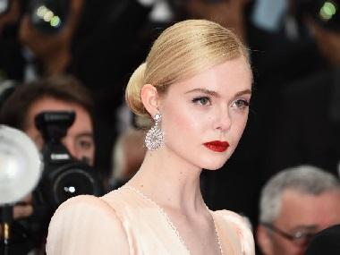 Cannes 2019 day 7 roundup: Elle Fanning faints at Chopard Trophee dinner; Alain Delon receives honorary Palme d'Or