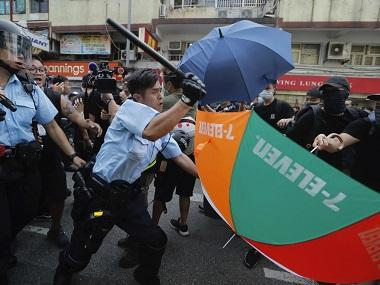Hong Kong clashes: Violence continues as police use force on thousands of protesters marching against traders from mainland China