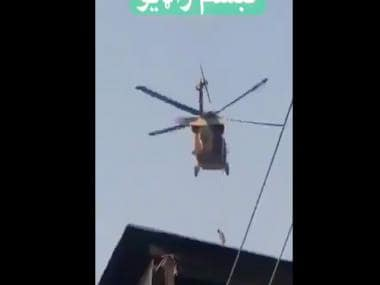 After US exit, Taliban fly American chopper with body hanging from rope; see video here
