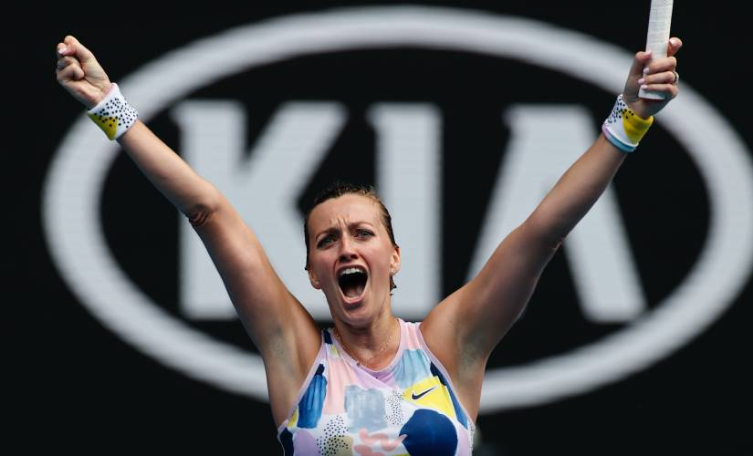 Petra Kvitova of the Czech Republic celebrates after defeating Greece's Maria Sakkari in their fourth round singles match at the Australian Open tennis championship in Melbourne, Australia, Sunday, Jan. 26, 2020. (AP Photo/Andy Wong)
