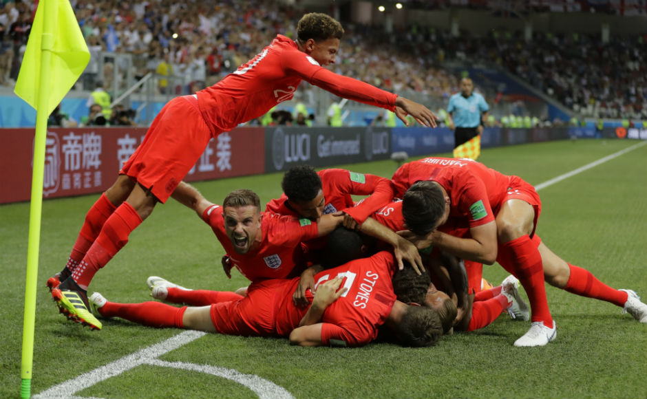 England players pile on each other after scoring the opening goal in their match against Tunisia. AP
