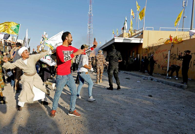 Protesters demonstrate at U.S. embassy in Iraq in new test for Trump