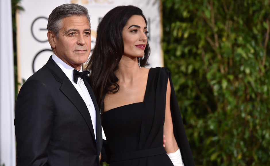 George Clooney, left, and Amal Clooney arrive at the 72nd annual Golden Globe Awards at the Beverly Hilton Hotel on Sunday, Jan. 11, 2015, in Beverly Hills, Calif. AP