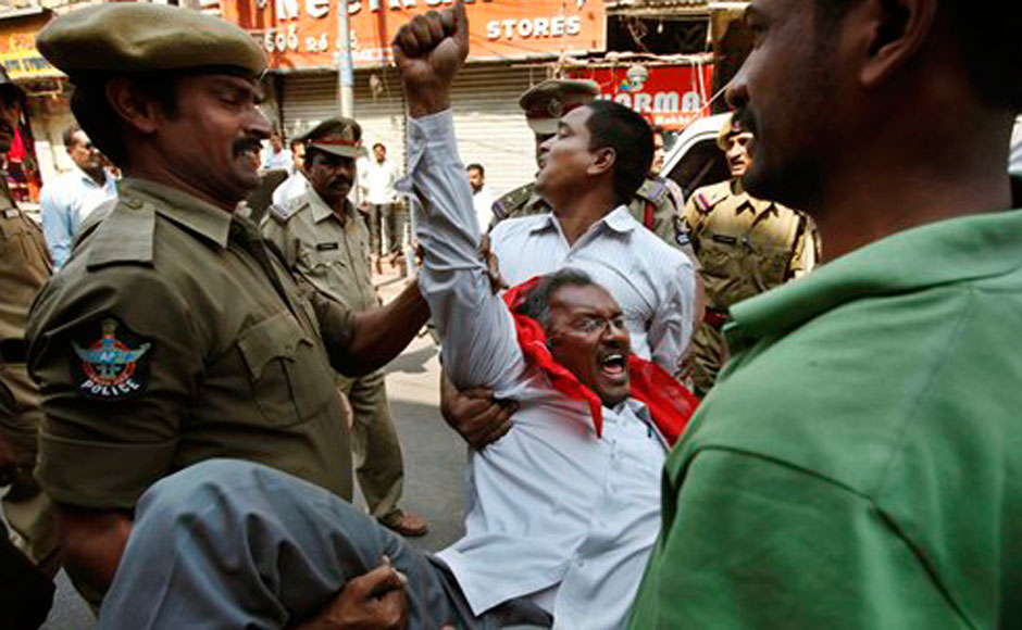 Police officers detain members of left wing parties during a protest in support of a one-day general strike in Hyderabad. AP