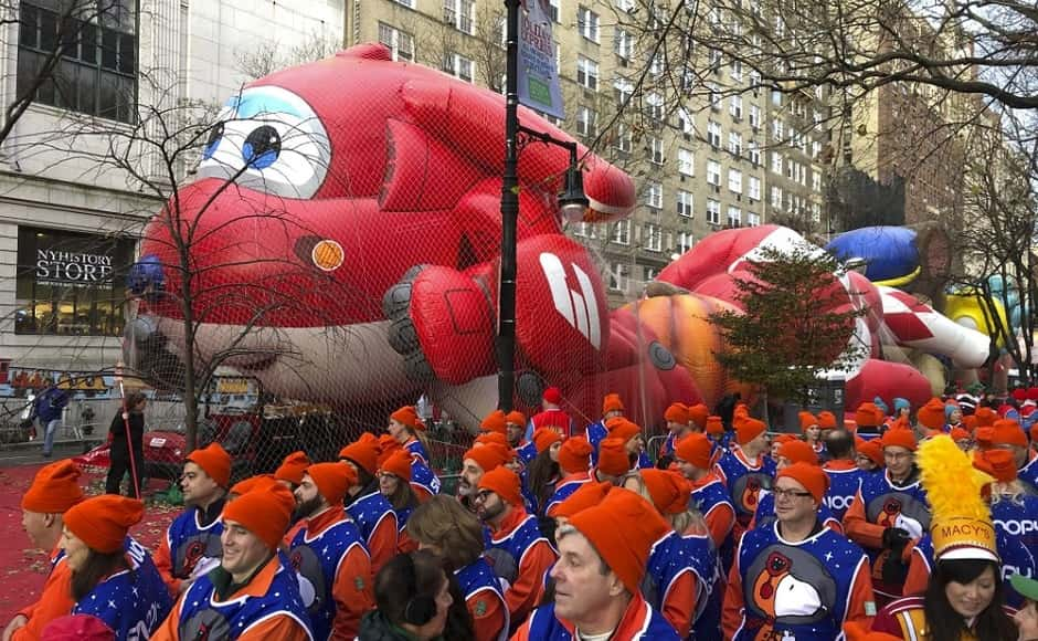 The parade, one of the city's most popular events, features about 8,000 marchers, two dozen floats, entertainers and marching bands, ending with an appearance from Santa Claus. Photo via The Associated Press/Mark Lennihan
