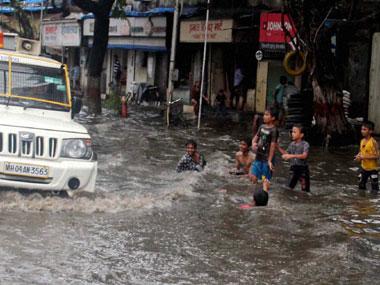 Torrential rains lash Mumbai, local trains delayed