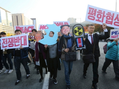 Fearing war with North Korea, hundreds of South Koreans protest Donald Trumps upcoming visit