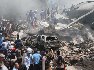 At least 116 feared dead in Indonesia military plane crash, say officials