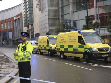 Four injured in stabbing at Manchester shopping mall; suspect in custody of counter-terror police, inquiry on