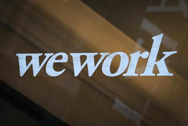SoftBank in talks to boost WeWork investment by <img class=