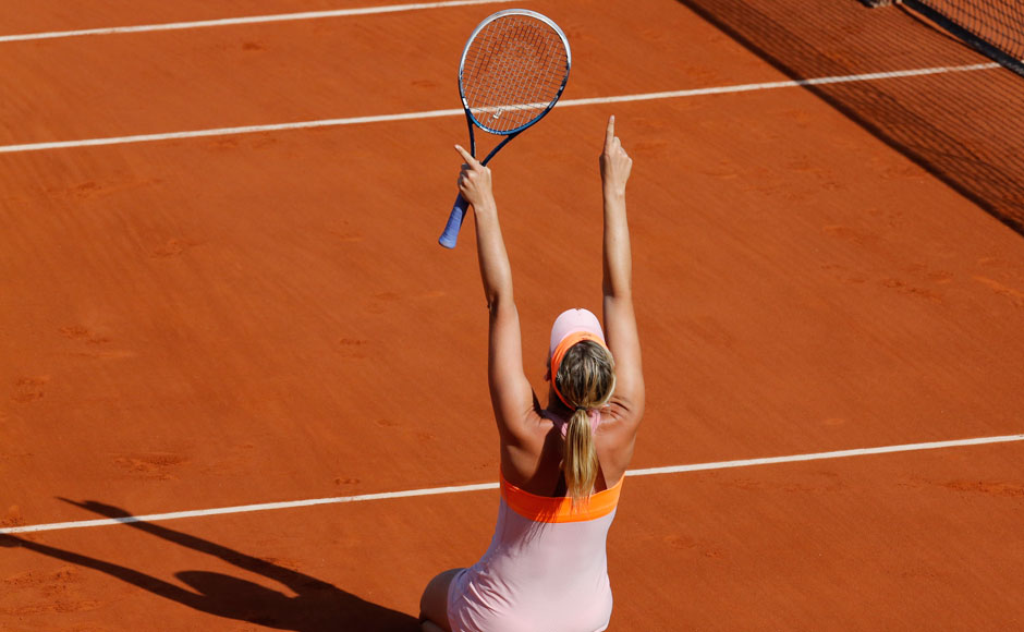 Maria Sharapova celebrates after winning her women's singles final match 6-4 6-7(5) 6-4 against Simona Halep at the French Open tennis tournament at the Roland Garros. Reuters