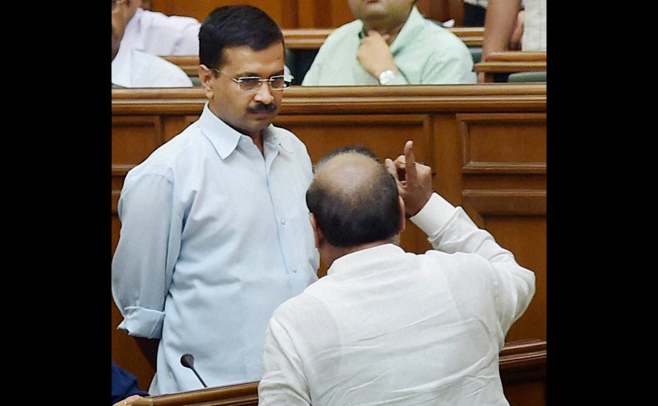 BJP MLA OP Sharma shout slogans in front of Delhi CM Arvind Kejriwal during a protest in the Assembly on the first day of the monsoon session in New Delhi on Tuesday. PTI