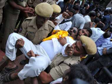Members of the Legislative Assembly (MLA) of Telugu Desam Party (TDP) during a protest opposite the state assembly after they tendered their resignations to back the decades-old demand for a separate state, in Hyderabad. Police arrested more than two dozen state lawmakers in southern India and teargassed students who were  demonstrating in support of a plan to create a new state.  Noah Seelam/AFP