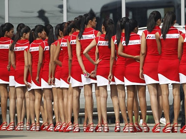 Formula One grid girls wait to enter the pit lane after the third practice session. Reuters