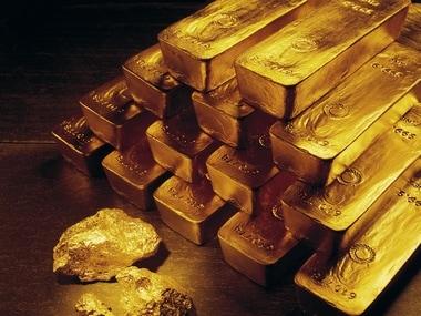 Gold edges up on EU's debt crisis plan expectation