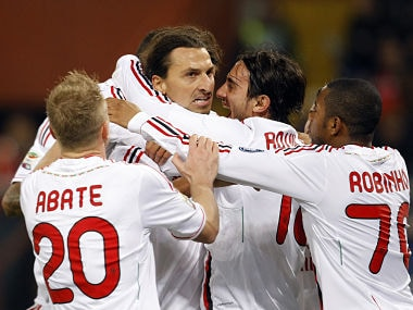 Milan go top despite Robinho miss and teargas