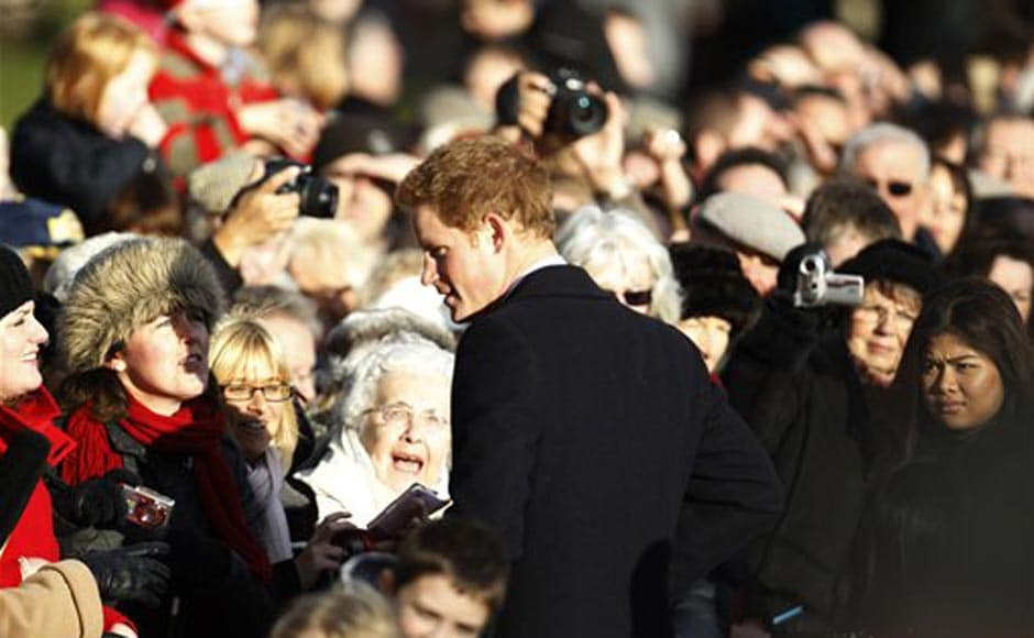 Britain's Prince Harry talks to well wishers after he and other members of Britain's royal family attended a Christmas Service at St. Mary's church in the grounds of Sandringham Estate, the Queen's Norfolk retreat, England. AP