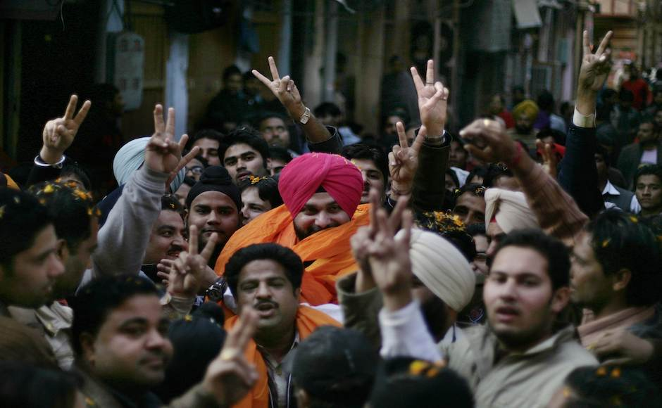 Supporters of India's main opposition Bharatiya Janata Party (BJP) leader and former Indian cricketer Navjot Singh Sidhu, center wearing pink turban, during his roadshow on the last day of campaigning for upcoming Assembly elections in Amritsar, India, Saturday, Jan. 28, 2012. (AP Photo/Altaf Qadri)