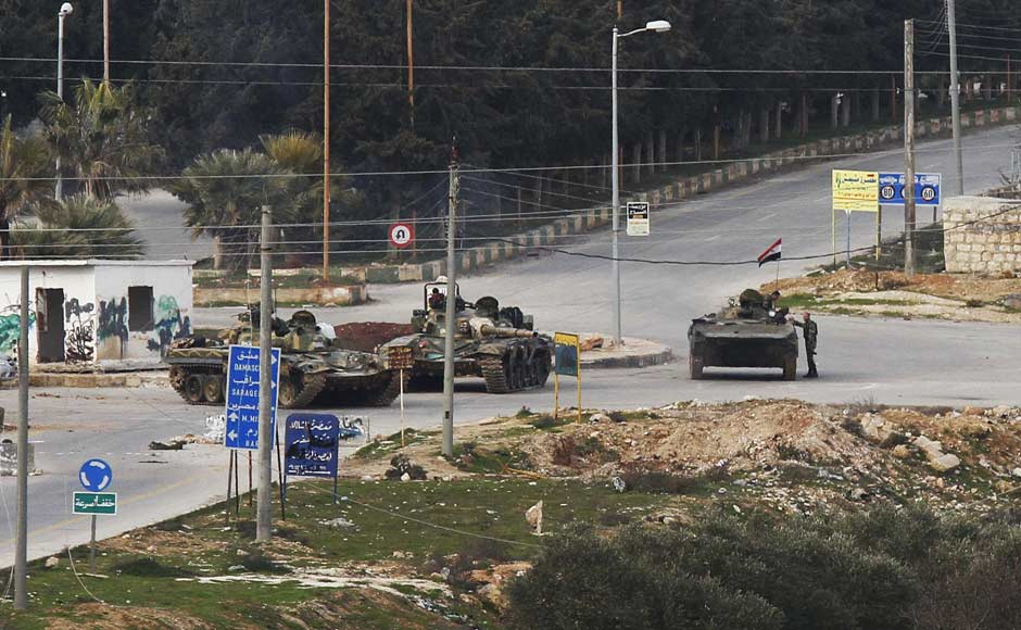 Syrian army tanks enter the northwestern city of Idlib, Syria. AP