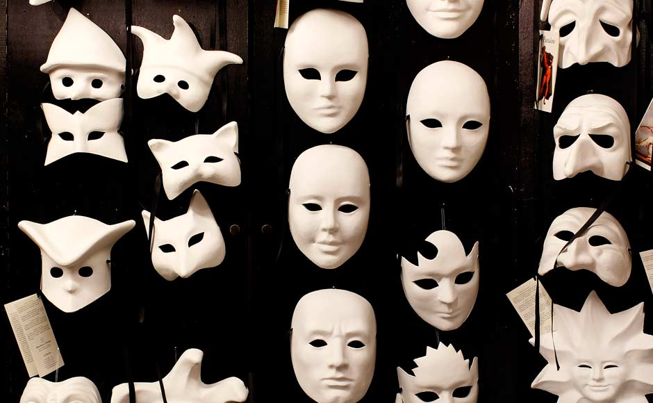 Masks are displayed in the workshop of a craftsman in downtown Venice. Reuters