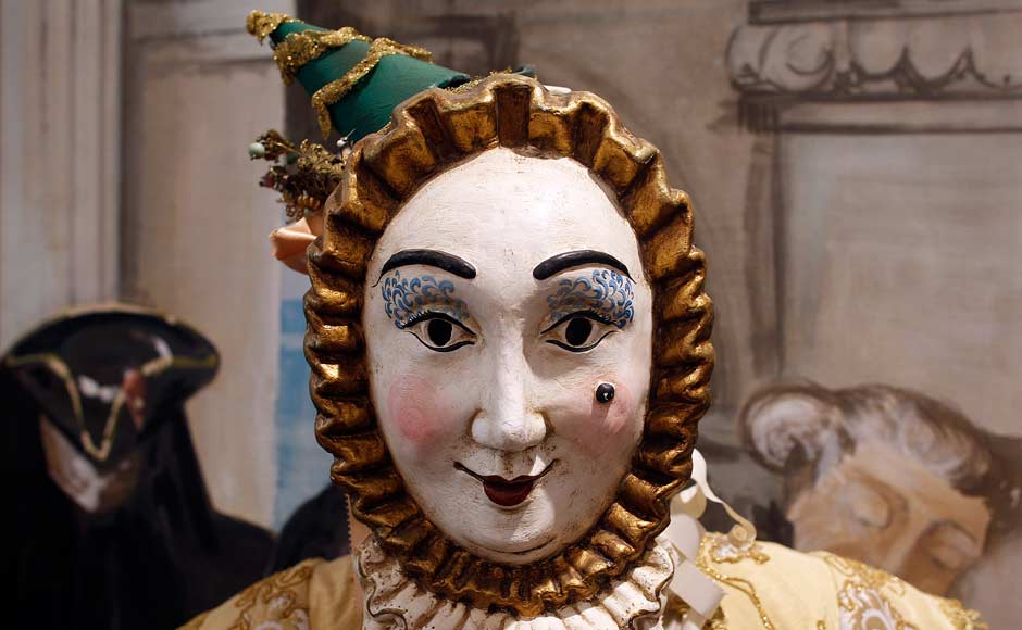 A traditional Venetian mask is displayed at the atelier of costume designer Stefano Nicolao in downtown Venice. Reuters