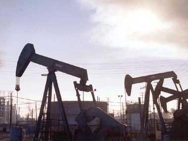 Oil prices jump to their highest in a month as US crude stocks fall, Middle East worries add support