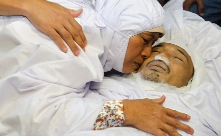 The Mother of Noramfaizul Mohd Nor, a Malaysian cameraman shot dead in the Somali capital, kisses her son, when his body arrives in Kuala Lumpur. Reuters
