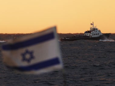 Israel lifts ban on Palestinian fishing boats, takes first step in implementing a fragile truce