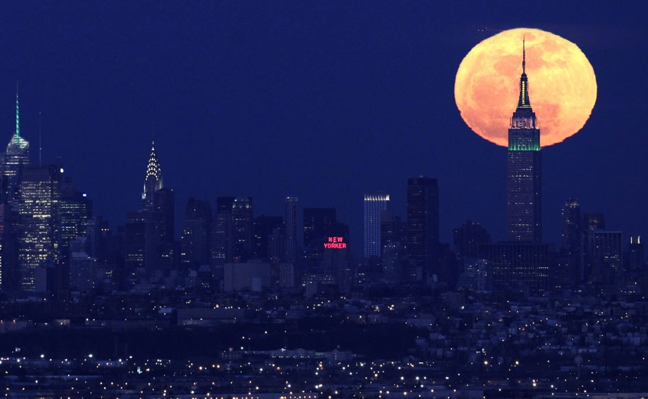 New York skyline with the supermoon in the background. AP