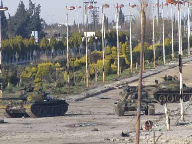 Clashes in Syria, activists accuse troops of war crimes