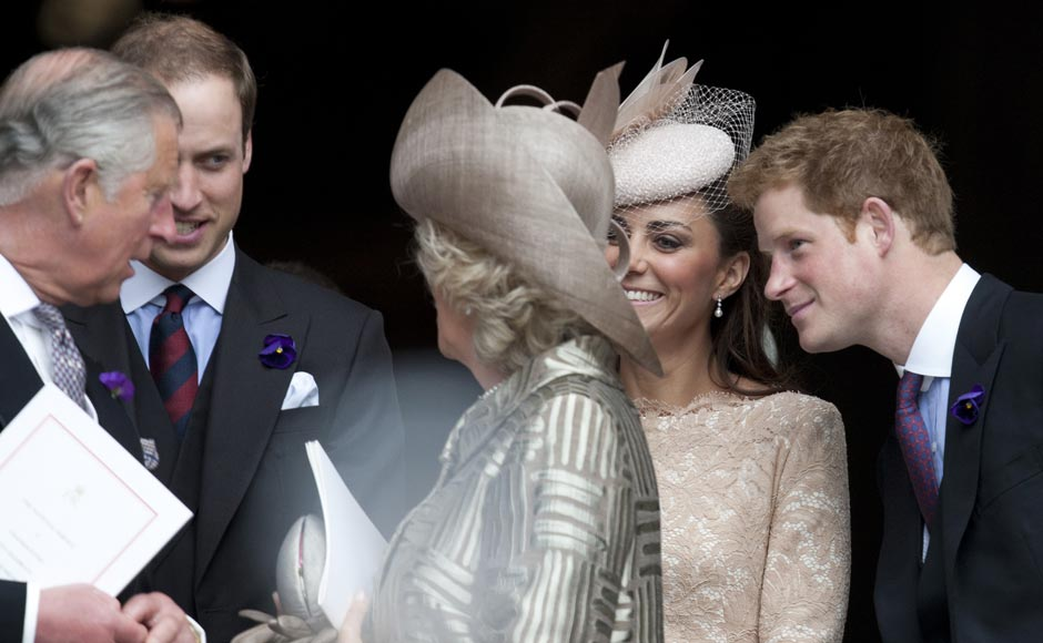 Britain's Prince Charles, left with Prince William, Camilla Duchess of Cornwall, Kate Duchess of Cambridge and Prince Harry talk together outside  St Paul's Cathedral following service of thanksgiving for the Queen's Diamond Jubilee  in London. AP