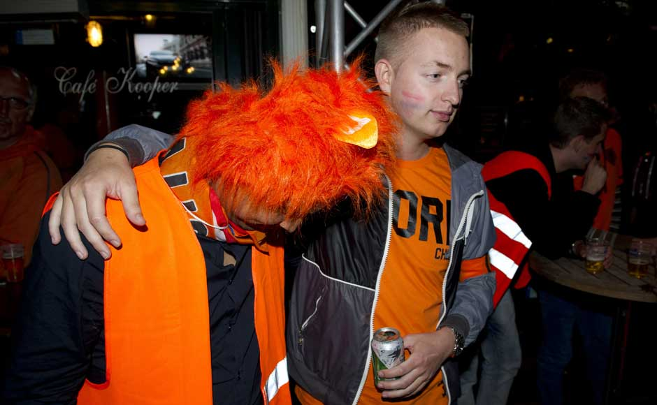 There, there the headgear is not so bad: Soccer fans react after watching the Euro 2012 soccer championship Group D match between the Netherlands and Germany outside a cafe on Leidseplein in Amsterdam, Netherlands. AP
