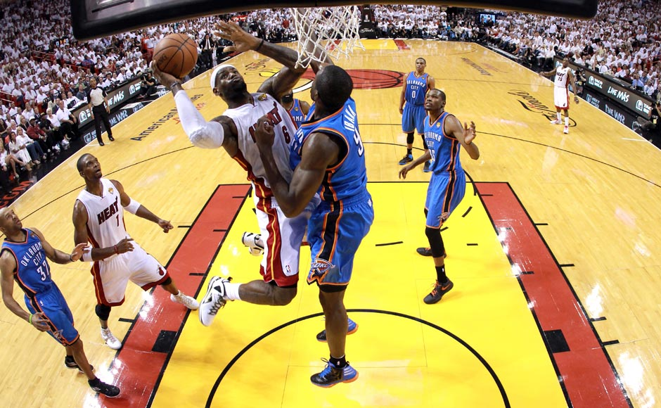 LeBron James #6 of the Miami Heat drives for a shot attemptm in the second half against Derek Fisher #37 of the Oklahoma City Thunder in Game Five of the 2012 NBA Finals on June 21, 2012 at American Airlines Arena in Miami, Florida. Getty Images
