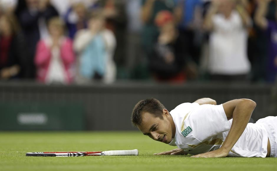 Lukas Rosol reacts after defeating Rafael Nadal in five sets in their second round match at Wimbledon.  AP