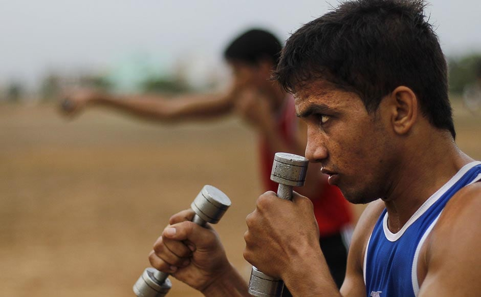 An amateur boxer from Bhiwani Boxing Club practices shadow boxing during a training session in Bhiwani. AP
