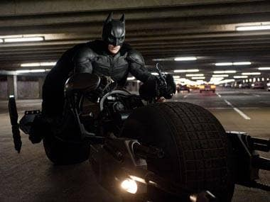 Movie Review: Emotion glows over spectacle as The Dark Knight Rises