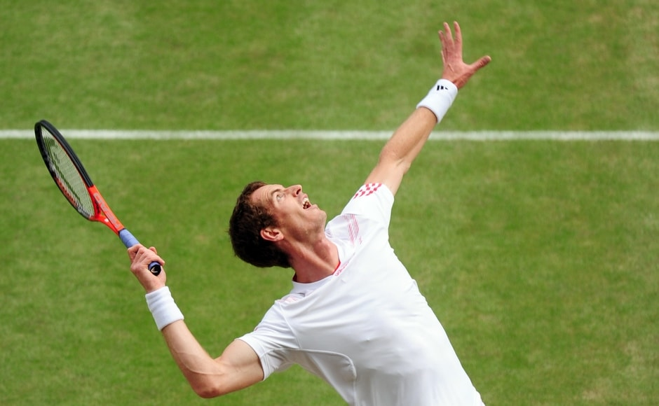 Murray reacts after defeating Jo-Wilfried Tsonga of France at their men's semi-final tennis match at the Wimbledon tennis championships in London July 6, 2012. Reuters