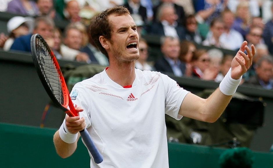 Murray reacts during his men's quarter-final tennis match against David Ferrer of Spain at the Wimbledon tennis championships in London July 4, 2012. Reuters