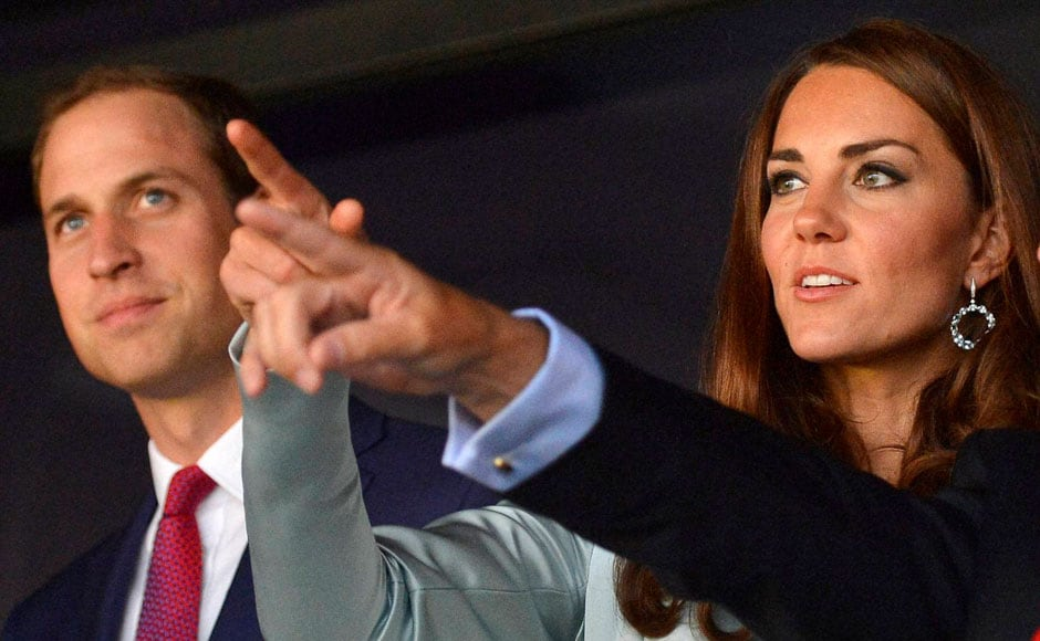 Britain's Prince William, the Duke of Cambridge, left, and his wife Britain's Catherine, Duchess of Cambridge wait for the beginning of the opening ceremony of the London 2012 Summer Olympic Games. AP/PTI