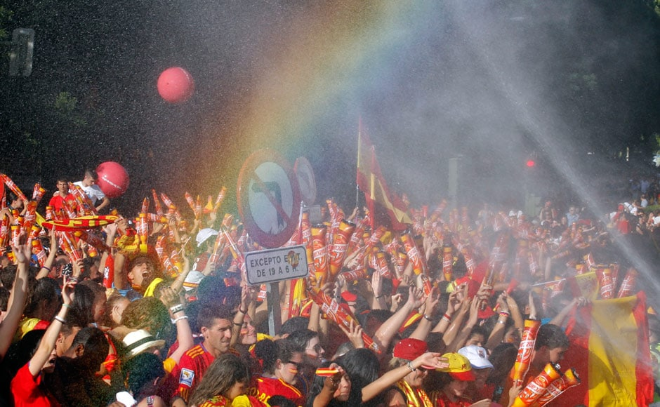 Supporters are sprayed with water as they wait for the arrival of their players to celebrate their Euro 2012 victory in downtown Madrid. Reuters